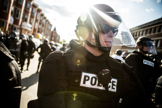 BALTIMORE, MD - APRIL 28:  Police officers stand watch near a CVS pharmacy that was burned to the ground yesterday during rioting after the funeral of Freddie Gray, on April 28, 2015 in Baltimore, Maryland. Gray, 25, was arrested for possessing a switch blade knife April 12 outside the Gilmor Houses housing project on Baltimore's west side. According to his attorney, Gray died a week later in the hospital from a severe spinal cord injury he received while in police custody.  (Photo by Andrew Burton/Getty Images)