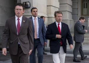WASHINGTON, DC - MAY 31: Sen. Rand Paul, R-Ky., right, leaves the U.S. Capitol with Rep. Thomas Massie, R-Ky. left, and Rep. Justin Amash, R-Mich., after Sen. Paul spoke at length on the Senate floor against an extension of provisions of the Patriot Act on Sunday, May 31, 2015.  (Photo By Bill Clark/CQ Roll Call) (CQ Roll Call via AP Images)