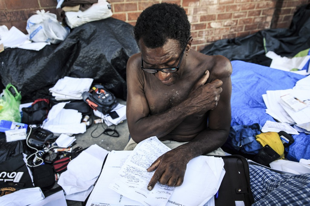 "Monty, 48 years old, lives in Towne Ave. which sits just a few blocks away from the much cleaner and protected area of Little Tokyo. His make-shift encampment is a completely covered in papers, some books and endless self-written notes. He explains, ""I work my ass off. I'm smarter than most motherfuckers on this block. You see my paperwork, I memorize half of this shit. I can look up a movie and tell you what casting director did that. That's what I do. That's what these are. Casting directors, producers, directors, writers, facebook, twitter, myspace, craigslist, youtube"". His goal is to go save money so he can go back  home to Indiana and apply for university theater degree."