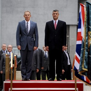 Former British Prime Minister Tony Blair (L) and Kosovo Prime Minister Hashim Thaci (R) review Kosovo's Security Force honour guard, during an official welcoming ceremony in Pristina on July 8, 2010.Blair is considered very highly by Kosovars for his role during the NATO air campaign over the Serbs, an objective which helped end the war in Kosovo. Blair, together with former USA President Bill Clinton, were the main actors that started NATO air strikes over the Serb Military Forces in the spring of 1999, which was crucial for the freedom of Kosovo and the expulsion of Serb police and military from Kosovo. This is the second visit of Tony Blair to Kosovo since the end of the war in 1999. AFP PHOTO/ARMEND NIMANI (Photo credit should read ARMEND NIMANI/AFP/Getty Images)