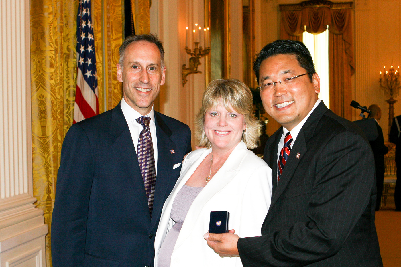 Jack Hawkins, Director of Volunteers for Prosperity (USAID) at the White House celebration of Asian Pacific Heritage Month.Kay Hiramine of Colorado Springs, Colo., recipient of the President's Volunteer Service award and Volunteers for Prosperity participant.