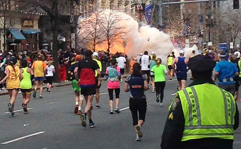 Image #: 21996457    Runners continue to run towards the finish line of the Boston Marathon as an explosion erupts near the finish line of the race in this photo exclusively licensed to Reuters by photographer Dan Lampariello after he took the photo in Boston, Massachusetts, April 15, 2013. Two simultaneous explosions ripped through the crowd at the finish line of the Boston Marathon on Monday, killing at least two people and injuring dozens on a day when tens of thousands of people pack the streets to watch the world famous race.  REUTERS EXCLUSIVE     REUTERS/Dan Lampariello  (UNITED STATES - Tags: CRIME LAW SPORT ATHLETICS TPX IMAGES OF THE DAY ) MANDATORY CREDIT: REUTERS /STRINGER /LANDOV