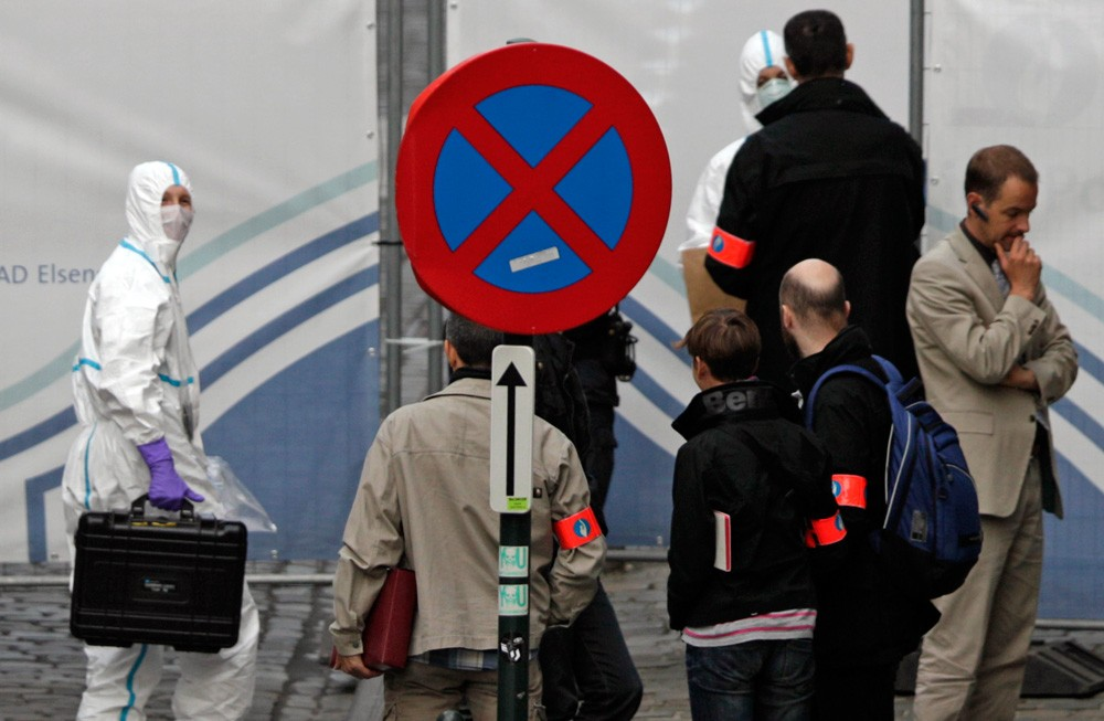 A forensic expert enters the site of a shooting, at the Jewish museum in Brussels, Saturday, May 24, 2014. Three people were killed and one seriously injured in a spree of gunfire at the Jewish Museum in Brussels on Saturday, officials said. The attack, which came on the eve of national and European Parliament elections, led officials to raise anti-terror measures.(AP Photo/Yves Logghe)