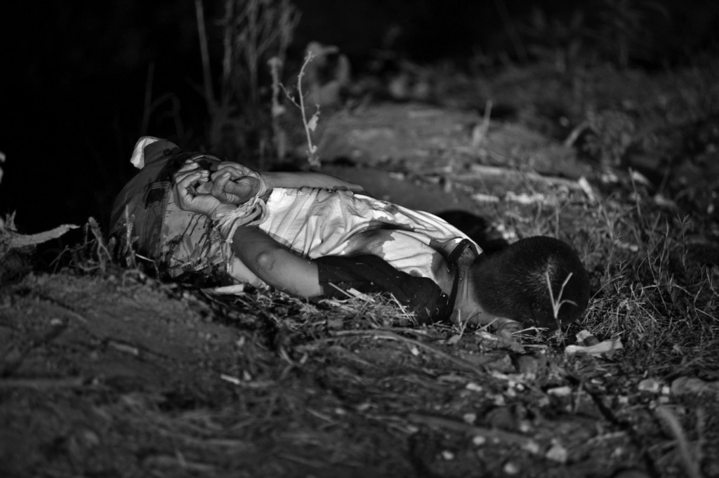 March 7, 2012 - Culiacan, Sinaloa, Mexico - A man with hands bound behind his back and killed execution style on the banks of a river. Culiacan is the cradle of many of the drug cartels and their leaders in Mexico. (Credit Image: © Louie Palu/zReportage/ZUMA)