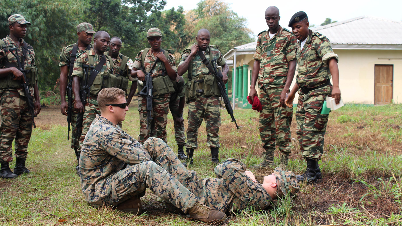 U.S. Marines and sailors are working with Cameroon's Fusiliers Marins (FUMA) and Compagnie des Palmeurs de Combat (COPALCO) to increase their capabilities to combat illicit activity and increase security in the waterways and borders of Cameroon. At the request of the Cameroonian government and through coordination with the U.S. Embassy in Yaounde, Marines and sailors with Special-Purpose Marine Air-Ground Task Force Crisis Response-Africa, are partnering with their military counterparts in infantry tactics in support of their maritime security force capabilities. The small team of Marines are currently attached to Africa Partnership Station, which is an international security cooperation initiative sponsored by U.S. Africa Command and facilitated by U.S. Naval Forces Africa (NAVAF), aimed at strengthening global maritime partnerships through training and other collaborative activities in order to improve maritime security and safety in Africa. The Marines and sailors are conducting training in combat marksmanship, patrolling, ambush techniques, close-quarters combat, tactical questioning and operations orders. (U.S. Marine Corps Photo by Sgt. Matthew Whitaker)
