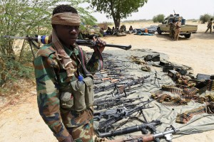 A Chadian soldier stand guard next to captured arms on April 3, 2015 in Malam Fatori, in northeastern Nigeria, which was retaken from Islamist Boko Haram militants by troops from neighbouring Chad and Niger. Soldiers from Chad and Niger on April 1, drove Boko Haram Islamist militants from the border town that was one of the insurgency's last footholds in northeastern Nigeria. AFP PHOTO/PHILIPPE DESMAZES (Photo credit should read PHILIPPE DESMAZES/AFP/Getty Images)