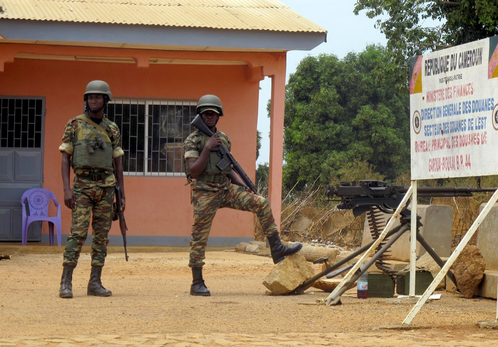 Cameroonian soldiers standing guard at the frontier post of Garoua-Boulai, March 13, 2014.