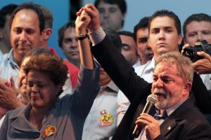 Brazil's Workers Party presidential candidate Dilma Rousseff, left, reacts as Brazil's President Luiz Inacio Lula da Silva speaks to supporters during a campaign rally in Goiania, Brazil, Tuesday, Oct. 19, 2010. Rousseff will face Jose Serra, presidential candidate of the Brazilian Social Democratic Party, PSDB, in an election runoff Oct. 31. (AP Photo/Eraldo  Peres)
