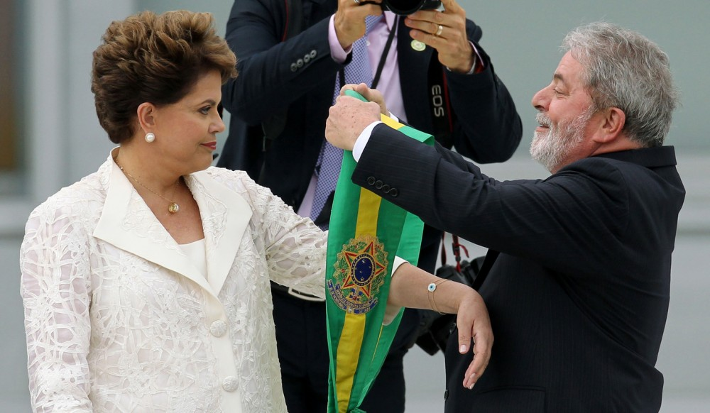 Brazil's President sworn in, Dilma Rousseff (L), receives the presidential sash from Brazil's President, Luiz Inacio Lula da Silva (R), during the inauguration ceremony at Planatlo Palace in Brasilia, Brazil, on Saturday, January 1, 2011. Rousseff, who is set to be the successor of Luiz Inacio Lula da Silva with the pledge of following his steps, is the first woman to take office in the Brazilian presidency. Photo: CELSO JUNIOR/AGÊNCIA ESTADO/AE (Agencia Estado via AP Images)