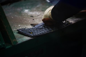 A workers dismantles a computer keyboard at the Super Dragon Technology Inc. e-waste processing facility in Taoyuan, Taiwan, on Wednesday, Jan. 13, 2016. Super Dragon extracts more than 50 kilograms of gold each month from the must-have electronic toys of yesteryear and the equipment that makes them. Photographer: Billy H.C. Kwok/Bloomberg via Getty Images