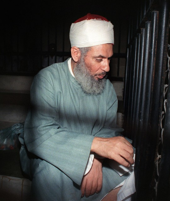 Blind Sheikh Omar Abdel Rahman sits and prays inside an iron cage at the opening of court session, 06 August 1989 in Cairo. Abdel-Rahman, spiritual leader of Egypt's main armed group the Moslem fundamentalist Jamaa Islamiyya, was jailed for life in January 1996 for his role in terrorist attacks, including blowing up the World Trade Center in New York in February 1993 and an assassination bid against Egyptian President Mubarak.        (Photo credit should read MIKE NELSON/AFP/GettyImages)