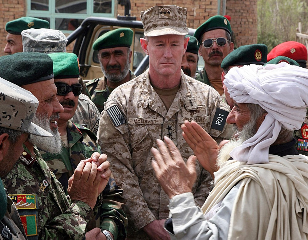 Commander of US Special Forces Vice Admiral William McRaven listens as Haji Sharabuddin, right (with white turban) greets Afghan National Army generals at a shura (meeting) near Gardez, Paktia province, Afghanistan, on April 8, 2010. US Special Forces were responsible for the deaths of five civilians, including three women and Haji Sharabuddin's two sons, during a bungled night raid in February 2010. The shura was called to ask Haji Sharabuddin's family for forgiveness. As per Afghan custom, a sheep is offered for sacrifice and blood money is paid.