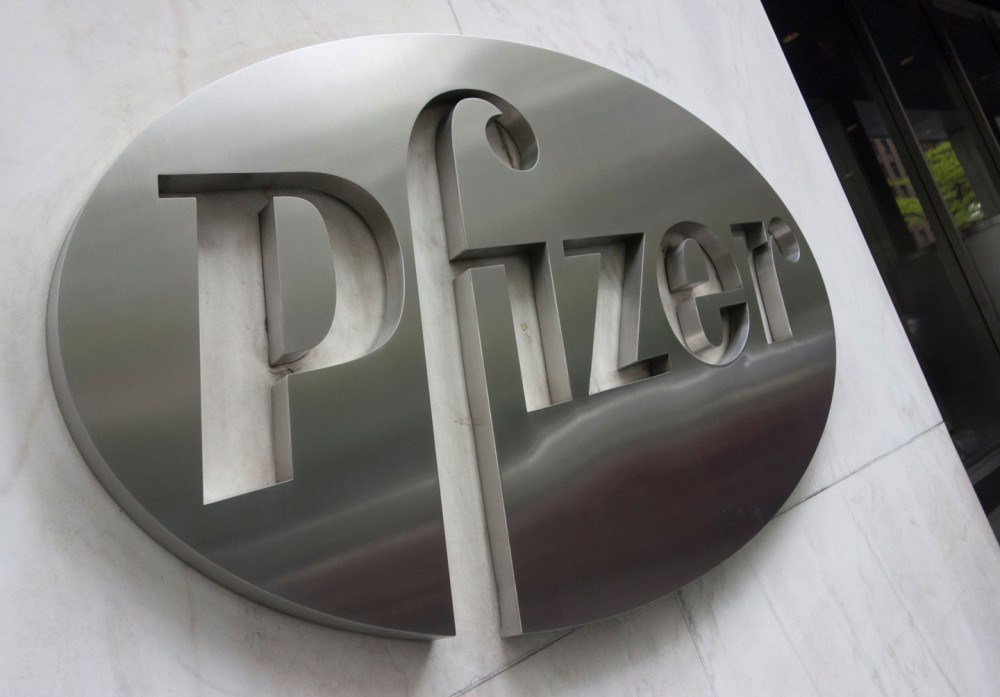 The Pfizer company logo as protesters from Doctors without Borders rally in front of Pfizers headquarters April 27, 2016 in New York.&lt;br /&gt;&lt;br /&gt;&lt;br /&gt;&lt;br /&gt;&lt;br /&gt;&lt;br /&gt;&lt;br /&gt;<br /> Doctors Without Borders delivered a petition signed by 370,000 people demanding a lower price for their lifesaving pneumonia vaccine. / AFP / DON EMMERT        (Photo credit should read DON EMMERT/AFP/Getty Images)