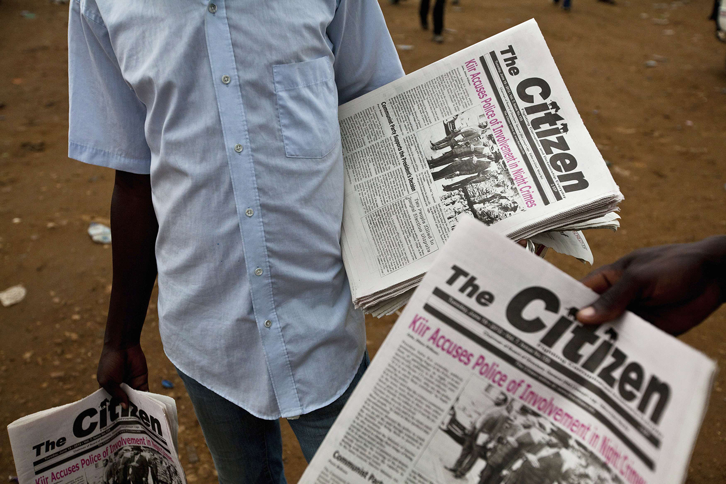 Newspaper vendors sell The Citizen newspaper at a bus station in Juba, June 19, 2012. In South Sudan, where most people get their news not from the Internet, newspapers or television but from the radio, Mading Ngor is about as big as journalists get. The 29-year-old is decidedly not impartial. But his brash, crusading reports and interviews on Bakhita Radio are required listening. Picture taken June 19, 2012. To match Special Report SOUTH-SUDAN/RADIO  REUTERS/Adriane Ohanesian (SOUTH SUDAN - Tags: ANNIVERSARY SOCIETY MEDIA BUSINESS) (Newscom TagID: rtrlfive359166.jpg) [Photo via Newscom]