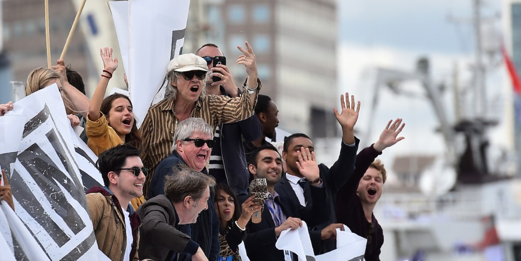 A boat carrying supporters for the Remain in the EU campaign including Bob Geldof (C) shout and wave at Brexit fishing boats as they sail up the river Thames in central London on June 15, 2016.A Brexit flotilla of fishing boats sailed up the River Thames into London today with foghorns sounding, in a protest against EU fishing quotas by the campaign for Britain to leave the European Union. / AFP / BEN STANSALL (Photo credit should read BEN STANSALL/AFP/Getty Images)