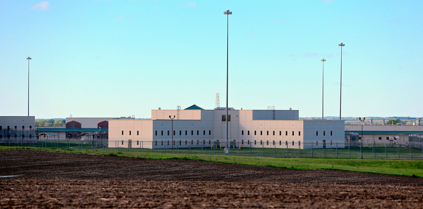 FILE- In this May 11, 2015 file photo, a housing unit is seen at sun rise at the Tecumseh State Correctional Institution in Tecumseh, Neb., Monday, May 11, 2015. Nebraska is the latest state to shift its focus to treatment and rehabilitation instead of building more prisons. Lawmakers increased behavioral health services and passed sentencing reforms to keep more low-level, nonviolent offenders out of prison. (AP Photo/Nati Harnik, file)