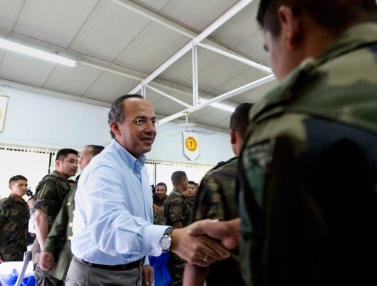 Mexican President Felipe Calderon greets a soldier after a breakfast at the base of the 43th Military zone in Apatzingan, Mexico on  Wednesday, Jan. 03, 2007. President Calderon, who sent 7,000 troops to his home state of Michoacan immediately after taking office on Dec. 1,  now has announced that is sending some 3,300 soldiers and federal police officers to fight drug gangs in the crime-plagued border city of Tijuana. (AP Photo/Guillermo Arias)