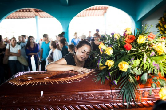 The wife of Manuel Mora (name withheld) cries over his casket, in La Ruana, Michoacán, Mexico, December 18, 2014.<br /> Manuel Mora was killed in a confrontation between two rival vignette groups, including one led by Hipolito Mora and on named 'H3'. The conflict left eleven people dead.