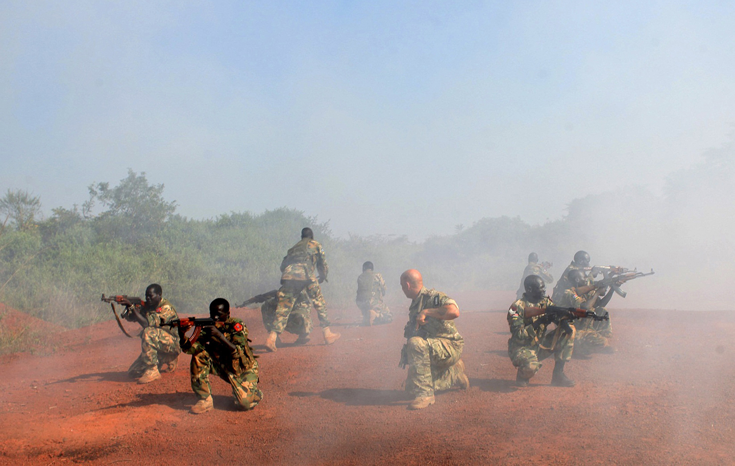 A U.S. Special Forces trainer supervises a military assault drill for a unit within the Sudan People's Liberation Army (SPLA) conducted in Nzara on the outskirts of Yambio November 29, 2013. REUTERS/Andreea Campeanu (SOUTH SUDAN - Tags: MILITARY) (Newscom TagID: rtrlsix165172.jpg) [Photo via Newscom]