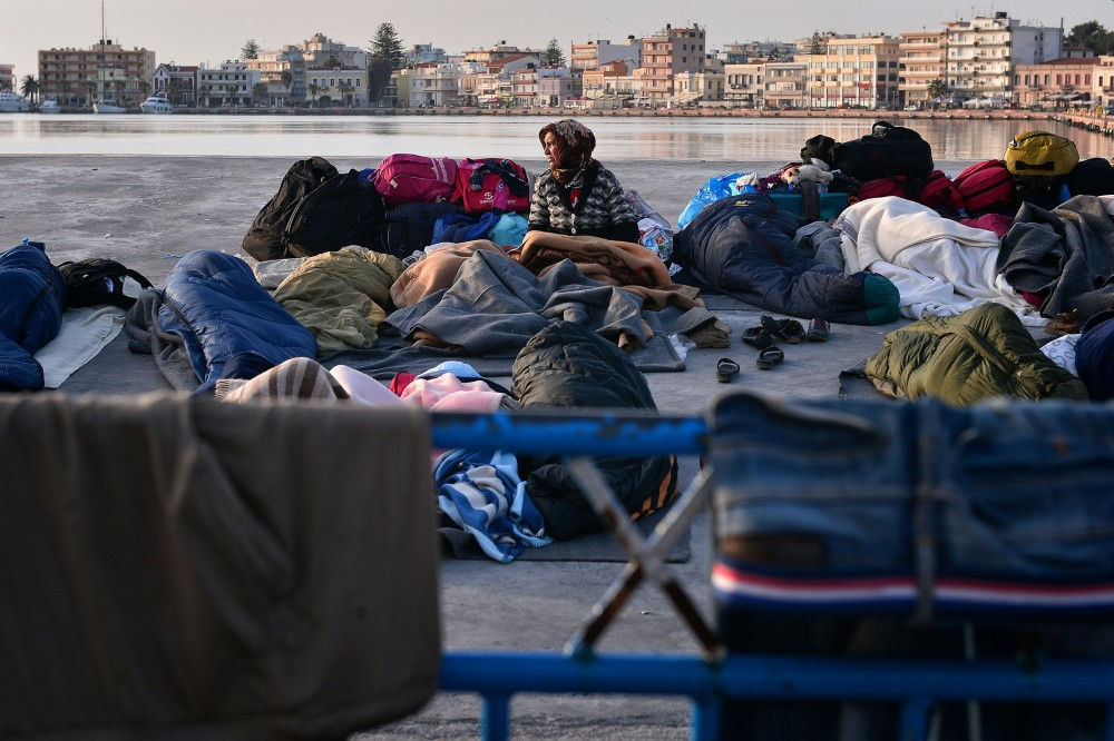 A woman wakes up in the port of Chios, where refugees and migrants who managed to leave the VIAL detention center a few days ago are camping out on April 5, 2016.<br /&gt<br /&gt<br /&gt<br /&gt<br /&gt<br /&gt<br /&gt<br /&gt<br /&gt<br /&gt<br /&gt<br /&gt<br /&gt<br /&gt<br /&gt<br /&gt Greece sent a first wave of migrants back to Turkey on April 4 under an EU deal that has faced heavy criticism from rights groups. Under the agreement, designed to halt the main influx which comes from Turkey, all