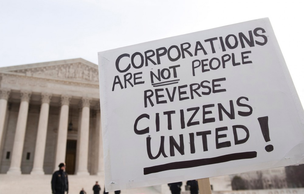 "UNITED STATES – JANUARY 20: Move to Amend holds a rally at the Supreme Court to ""Occupy the Courts"" and mark the second anniversary of the Citizens United v. FEC Supreme Court case on Friday, Jan. 20. 2012. (Photo By Bill Clark/CQ Roll Call) (CQ Roll Call via AP Images)"
