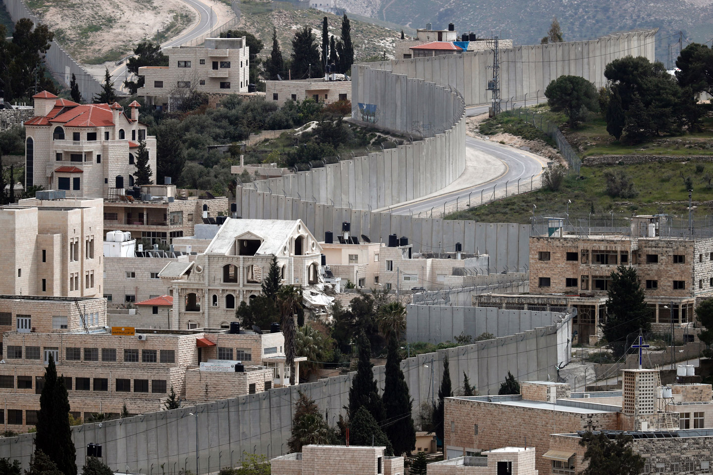 A general view show Israel's controversial separation barrier dividing the West Bank city of Abu Dis (L) and the Israeli annexed East Jerusalem on March 24, 2016. / AFP / THOMAS COEX        (Photo credit should read THOMAS COEX/AFP/Getty Images)