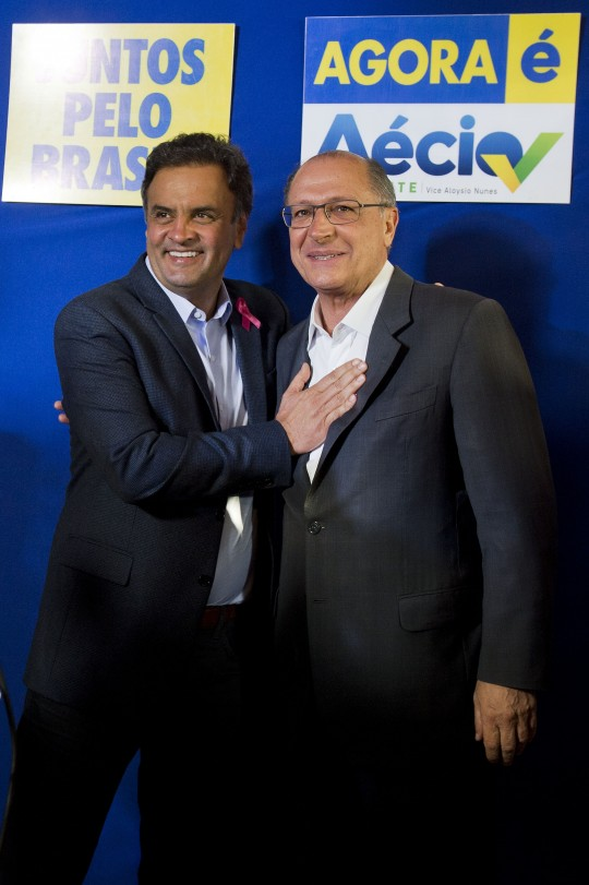 Brazil's presidential candidate for the Brazilian Social Democracy Party (PSDB) Aecio Neves (L) greets Sao Paulo state governor Geraldo Alckmin (R) before a press conference at the campaign committe in Sao Paulo, on October 6, 2014. Aecio Neves will face Dilma Rousseff in a run-off election on October 26. AFP PHOTO / NELSON ALMEIDA        (Photo credit should read NELSON ALMEIDA/AFP/Getty Images)