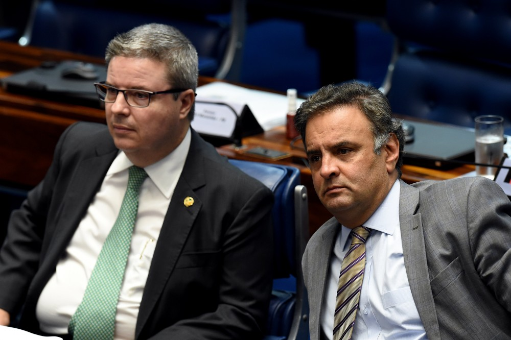 Senator Aecio Neves (R), who heads the PSDB opposition party, sits next to senator Antonio Anastasia, also from the PSDB, during a senate's session to form a committee that will consider whether to impeach President Dilma Rousseff, in Brasilia, on April 25, 2016.<br /><br /><br /><br /><br /><br /><br /><br /> Brazil's Senate met Monday to form a committee that will consider whether to impeach Rousseff, who has accused her opponents of mounting a constitutional coup. She is accused of illegal government accounting maneuvers, but says she has not committed an impeachment-worthy crime. The Senate committee -- comprising 21 of the 81 senators -- was to debate Rousseff's fate for up to 10 working days before making a recommendation to the full upper house.<br /><br /><br /><br /><br /><br /><br /><br />  / AFP / EVARISTO SA        (Photo credit should read EVARISTO SA/AFP/Getty Images)