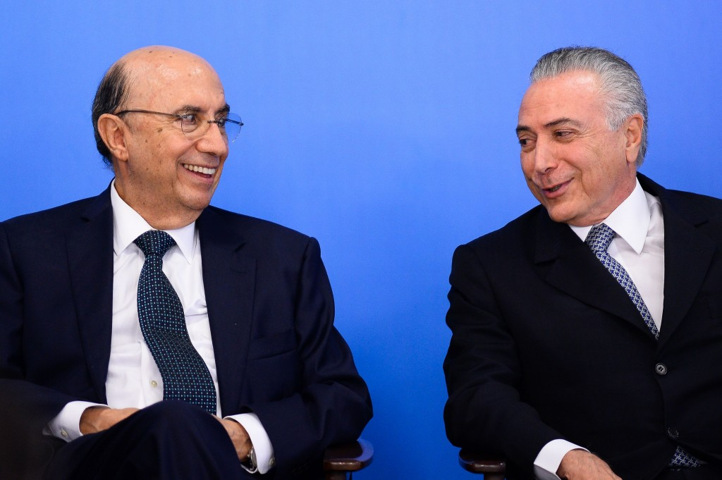 Brazilian Finance Minister Henrique Meirelles (L) and acting President Michel Temer attend a meeting with business leaders at Planalto Palace in Brasilia, June 8, 2016.<br /><br /><br /><br /><br /><br /> Brazil's annual inflation rate crept up last month to 9.32 percent, officials said Wednesday, sounding new alarm bells for Latin America's largest economy as it struggles through a deep recession. The stubbornly high inflation rate had been looking somewhat better recently, falling in each of the past three months, to 9.28 percent in April. / AFP / ANDRESSA ANHOLETE        (Photo credit should read ANDRESSA ANHOLETE/AFP/Getty Images)