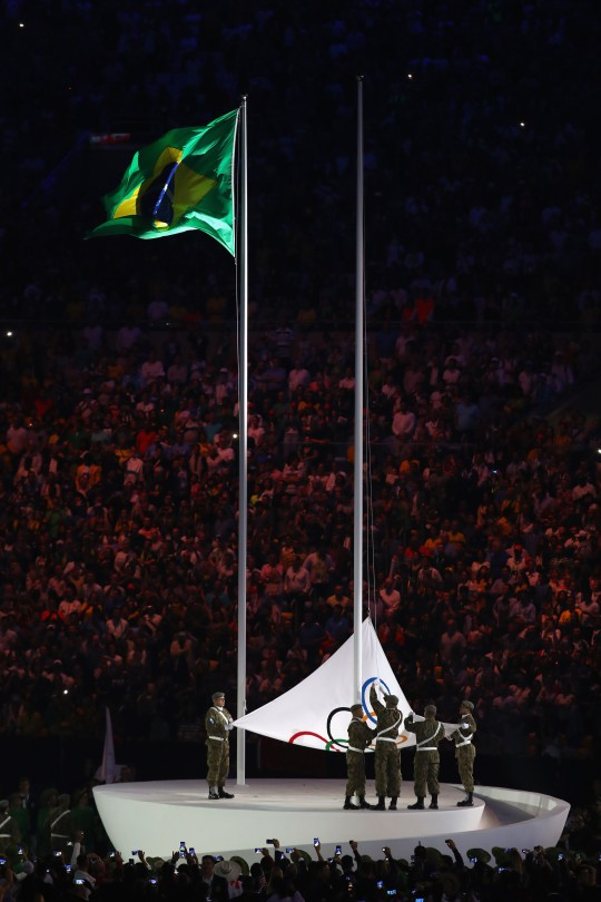 RIO DE JANEIRO, BRAZIL - AUGUST 05:  The Olympic flag is raised during the Opening Ceremony of the Rio 2016 Olympic Games at Maracana Stadium on August 5, 2016 in Rio de Janeiro, Brazil.  (Photo by Clive Brunskill/Getty Images)