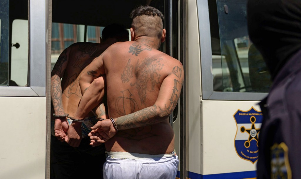 Alleged members of the MS13 and 18 gang board a police vehicle after being presented to the press in San Salvador on February 26, 2016. Members of the national civil police and the armed forces captured 240 dangerous gang members accused of homicide and extortion in the last three days in different areas of El Salvador, informed Friday the public prosecutor's office. El Salvador faces an escalation of violence attributed mostly to the war between the MS-13 and 18 ST gangs. AFP PHOTO / Marvin RECINOS / AFP / Marvin RECINOS        (Photo credit should read MARVIN RECINOS/AFP/Getty Images)