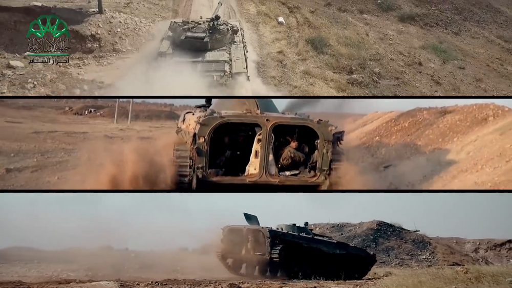 "Scene from ""Rage Wind"" film showing militia members operating armored vehicles."
