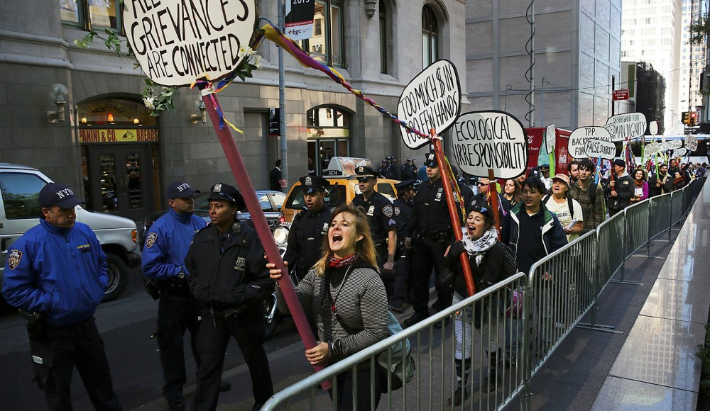 NEW YORK, NY - SEPTEMBER 17:  Protesters affiliated with Occupy Wall Street demonstrate for a variety of causes at Zuccotti Park near the New York Stock Exchange on the second anniversary of the movement on September 17, 2013 in New York City. Numerous rallies and events across the city were planned for the movement which takes aim at inequality and financial greed and which has influenced activist moments around the world. While police presence was high in New York, with a helicopter flying above the park, no incidents had been reported by the afternoon.  (Photo by Spencer Platt/Getty Images)