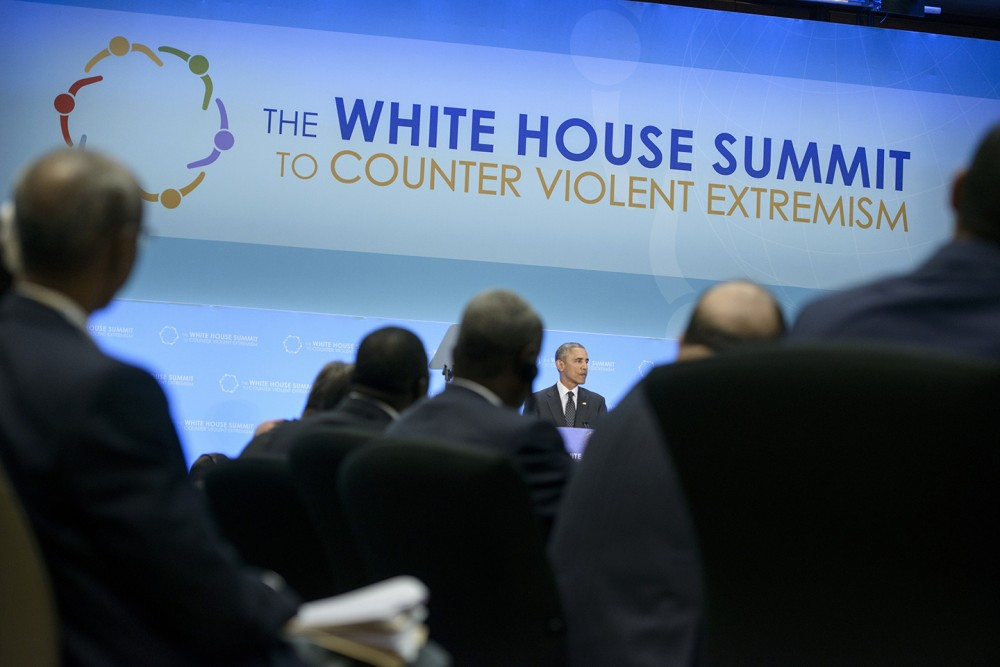 "US President Barack Obama speaks during the White House Summit on Countering Violent Extremism at the US State Department February 19, 2015 in Washington, DC. Obama reiterated his call for the world to stand up to violent extremism Thursday, saying jihadists peddle a the lie that there is a clash of civilizations. ""The notion that the West is at war with Islam is an ugly lie,"" he told a three-day conference on combatting extremism. AFP PHOTO/BRENDAN SMIALOWSKI        (Photo credit should read BRENDAN SMIALOWSKI/AFP/Getty Images)"