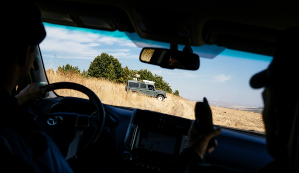 A Dutch and Bulgarian Border police officer ride a vehicle during a patrol near the border preventing illegal crossings by migrants at the Bulgarian-Turkish border near the Bulgarian village of Kapitan Andreevo, on October 7, 2016.   The EU launches its beefed-up border force in a rare show of unity by the squabbling bloc as it seeks to tackle its worst migration crisis since World War II. European Union officials inaugurate the new task force at the Kapitan Andreevo checkpoint on the Bulgarian-Turkish border, the main land frontier for migrants seeking to enter the bloc and avoid the dangerous Mediterranean sea crossing.  / AFP / DIMITAR DILKOFF        (Photo credit should read DIMITAR DILKOFF/AFP/Getty Images)