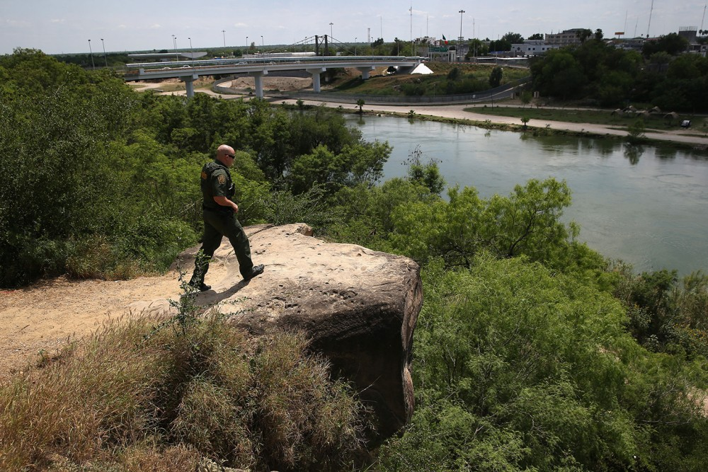 ROMA, TX - APRIL 14:  A Border Patrol agent scans for immigrants illegally crossing the Rio Grand into the United States on April 14, 2016 in Roma, Texas. Border security and immigration, both legal and otherwise, continue to be contentious national issues in the 2016 Presidential campaign.  (Photo by John Moore/Getty Images)