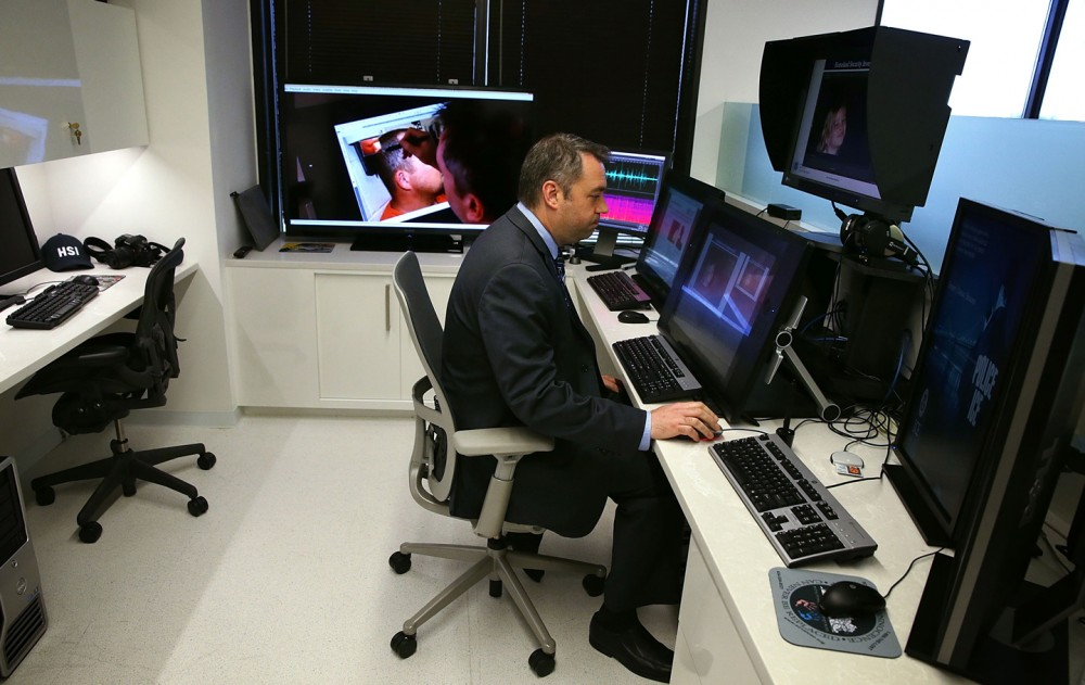 FAIRFAX, VA - JULY 22:  Special agent James Cole demonstrates during an unveiling of a major expansion of the ICE Cyber Crimes Center July 22, 2015 in Fairfax, Virginia. The center delivers computer and cyber-based technical services in support of ICE Homeland Security Investigations (HSI) cases.  (Photo by Alex Wong/Getty Images)