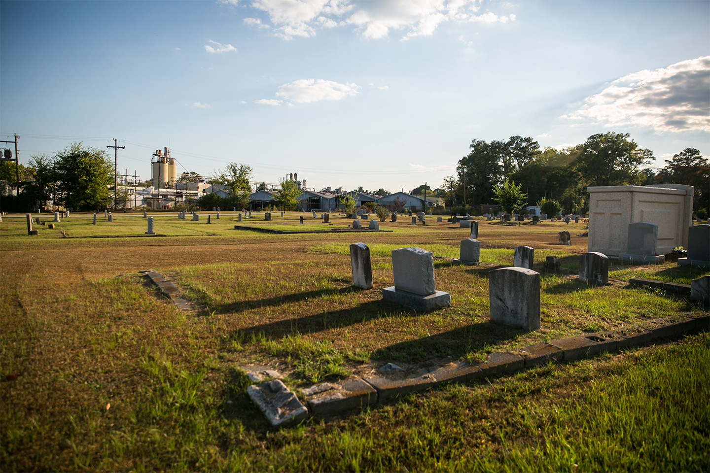 Union Cemetery lines the old Kerr McGee site between the now closed Sanderson Plumbing Products factory in Columbus, Mississippi. The graveyard is located between the two properties, surrounded by metal fencing on each side.