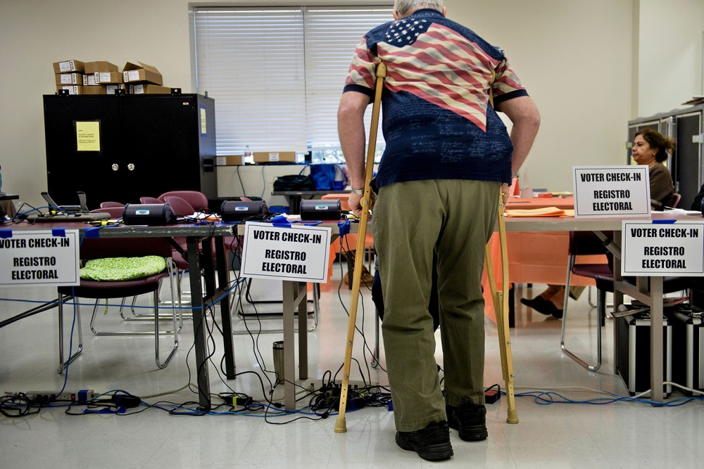 A man checks-in at the Activity Center at Bohrer Park during early voting on October 28, 2016 in Gaithersburg, Maryland. / AFP / Brendan Smialowski        (Photo credit should read BRENDAN SMIALOWSKI/AFP/Getty Images)