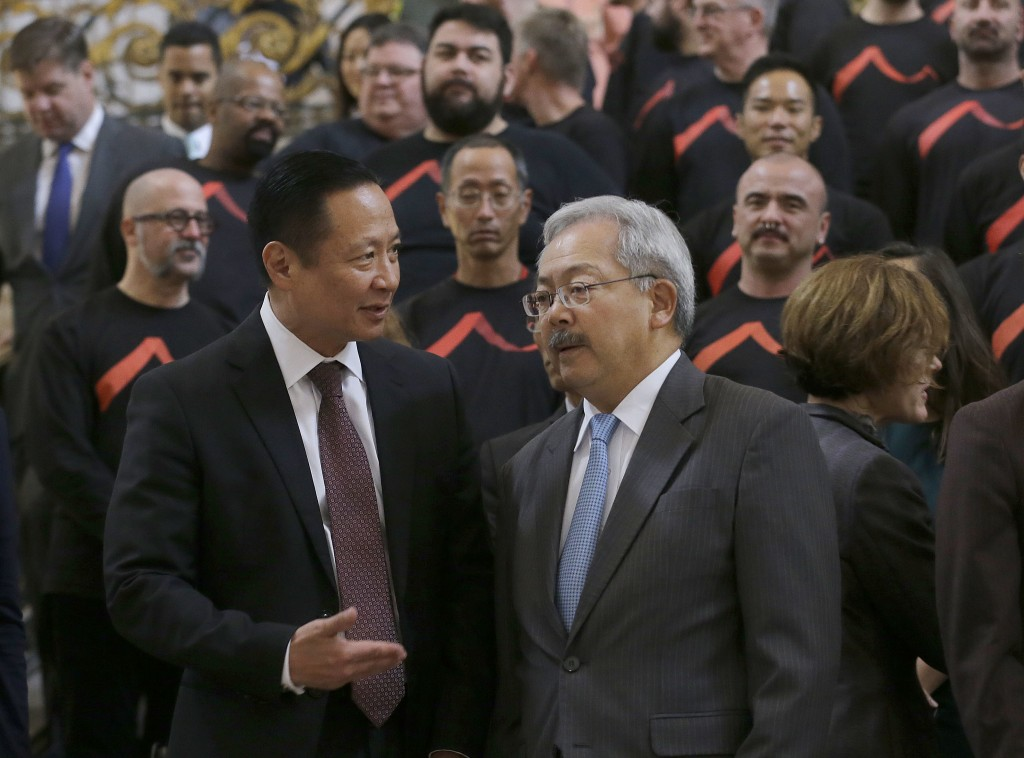 San Francisco Mayor Ed Lee, right, speaks with Public Defender Jeff Adachi before a meeting at City Hall in San Francisco by city leaders and community activists to reaffirm the city's commitment to being a sanctuary city in response to Donald Trump's support of deportations and other measures against immigrants Monday, Nov. 14, 2016. (AP Photo/Jeff Chiu)