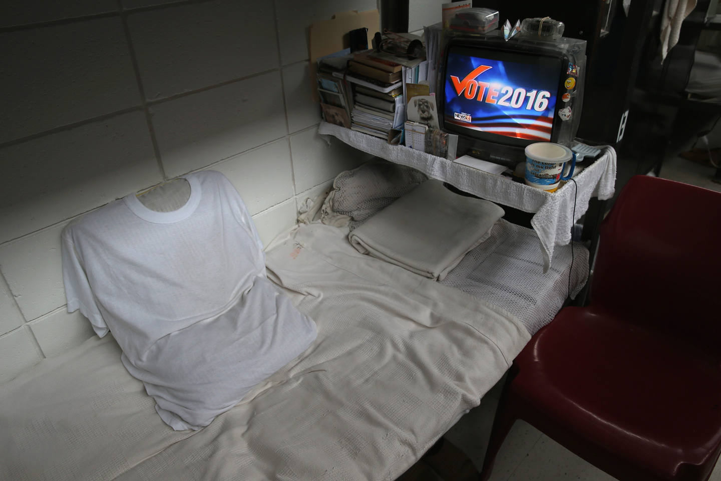"ENFIELD, CT - MAY 03:  Television news features Donald Trump over a prisoner's bunk at the Veterans Unit of the Cybulski Rehabilitation Center on May 3, 2016 in Enfield, Connecticut. Connecticut is one of only four states where voting rights are restored to convicted criminals immediately upon completion of their prison and parole time. The Veterans Unit houses some 110 inmates, all U.S. military veterans convicted of crimes ranging from petty larceny to murder. Prisoners at the unit typically have less than two years left on their sentences. The unit is part of a Connecticut Department of Correction program to turn some prisons into reintegration centers to prepare inmates for successful re-entry into society. Criminal justice and prison reforms are taking hold with bi-partisan support nationwide in an effort to reduce prison populations and recidivism. The state's criminal justice reforms fall under Connecticut Governor Dannel Malloy's ""Second Chance Society"" legislation.  (Photo by John Moore/Getty Images)"