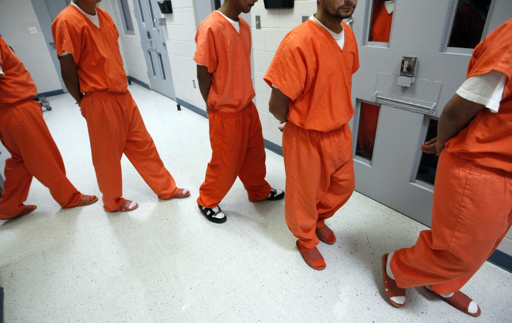 New federal inmates prepare to undergo health screenings while being processed at the Val Verde Correctional Facility in Del Rio, Texas.  (Photo by Tom Pennington/Fort Worth Star-Telegram/MCT via Getty Images)