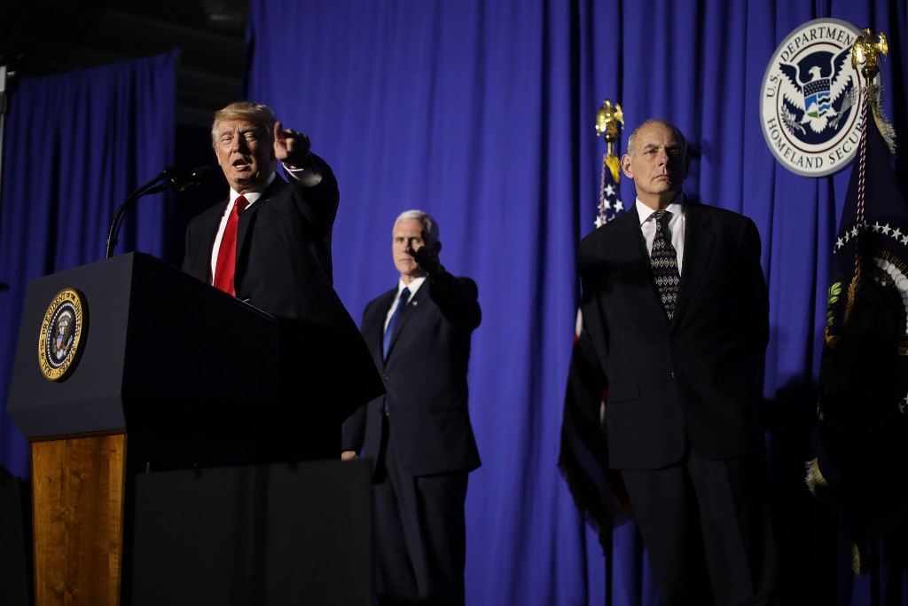 WASHINGTON, DC - JANUARY 25:  (AFP OUT) U.S. President Donald Trump (L) delivers remarks during a visit to the Department of Homeland Security with Vice President Mike Pence (C) and Homeland Security Secretary John Kelly January 25, 2017 in Washington, DC. While at the department, Trump signed two executive orders related to internal security and to begin the process of building a wall along the U.S.-Mexico border.  (Photo by Chip Somodevilla/Getty Images)