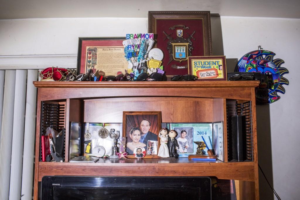 TIJUANA, MX. - APRIL 7 2016:  A portrait of Sanchez-Paulsen's family on a shelf in the living room of her Tijuana home. Natalie Keyssar
