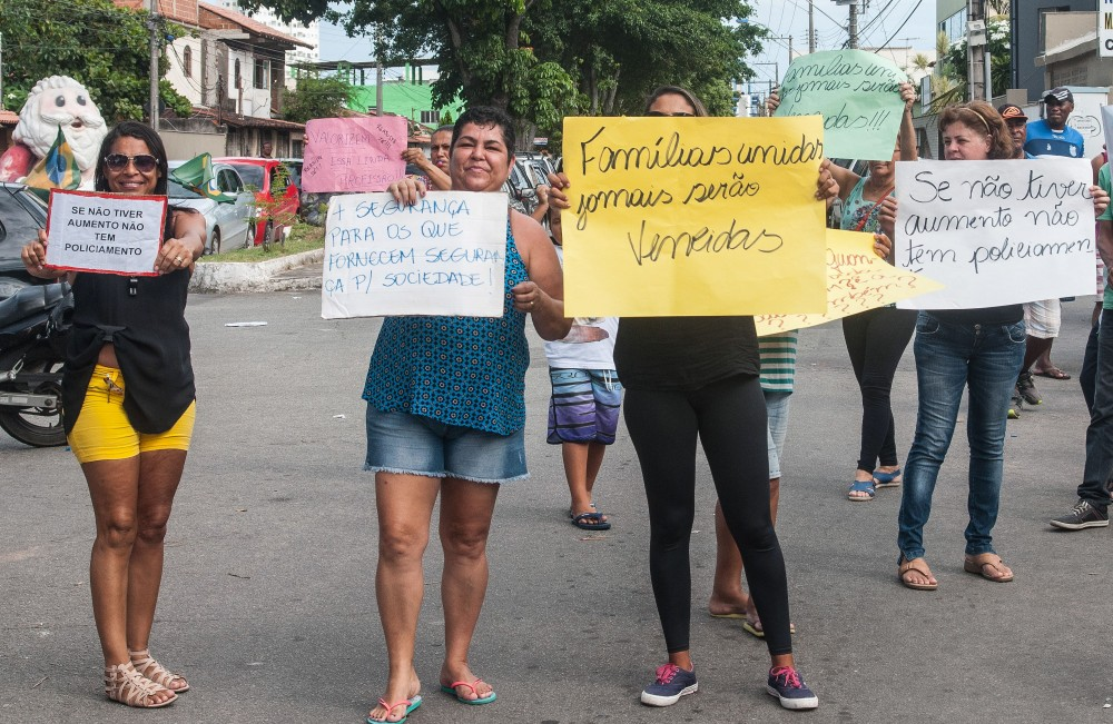 Relatives of military police show signs during a protest in support of a police strike at the entrance of a police station in Vila Velha, near Vitoria, in eastern Brazil on February 6, 2017.<br /><br /><br /><br /><br /><br /><br /><br /><br /><br /><br /><br /><br /><br /><br /><br /><br /><br /><br /><br /><br /><br /><br /><br /><br /><br /><br /><br /> Brazil's government authorized deployment of troops Monday to the coastal city of Vitoria, which has been left at the mercy of criminals following a police strike.<br /><br /><br /><br /><br /><br /><br /><br /><br /><br /><br /><br /><br /><br /><br /><br /><br /><br /><br /><br /><br /><br /><br /><br /><br /><br /><br /><br /> / AFP / Vinicius MORAES (Photo credit should read VINICIUS MORAES/AFP/Getty Images)