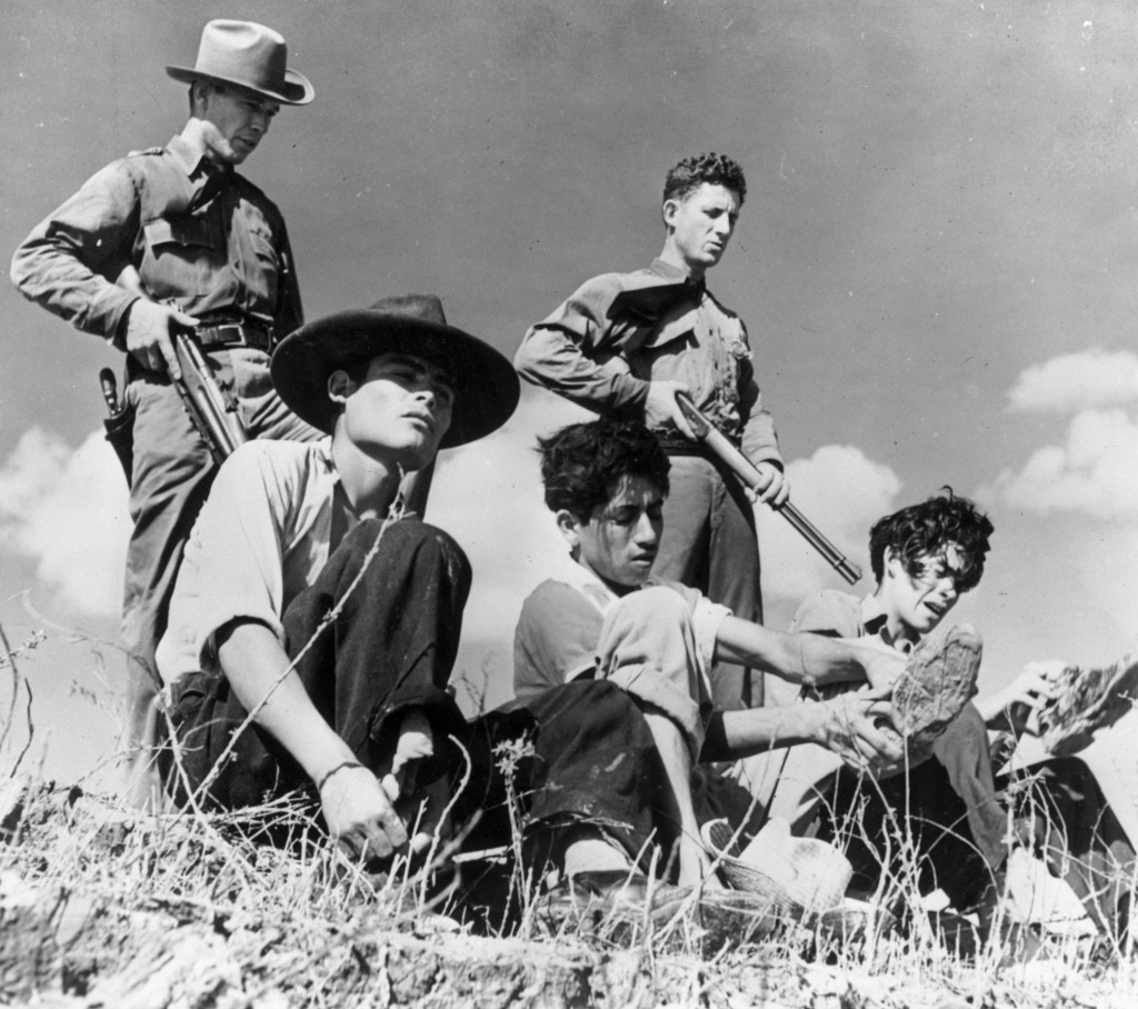 June 1948:  Members of the Texas Border Patrol guarding illegal Mexican immigrants captured close to the Mexican border. They will be questioned in the hope they have information leading to the capture of the gangs of murderers who prey on the captured immigrants returning to Mexico.  (Photo by Harry Pennington/Keystone Features/Getty Images)