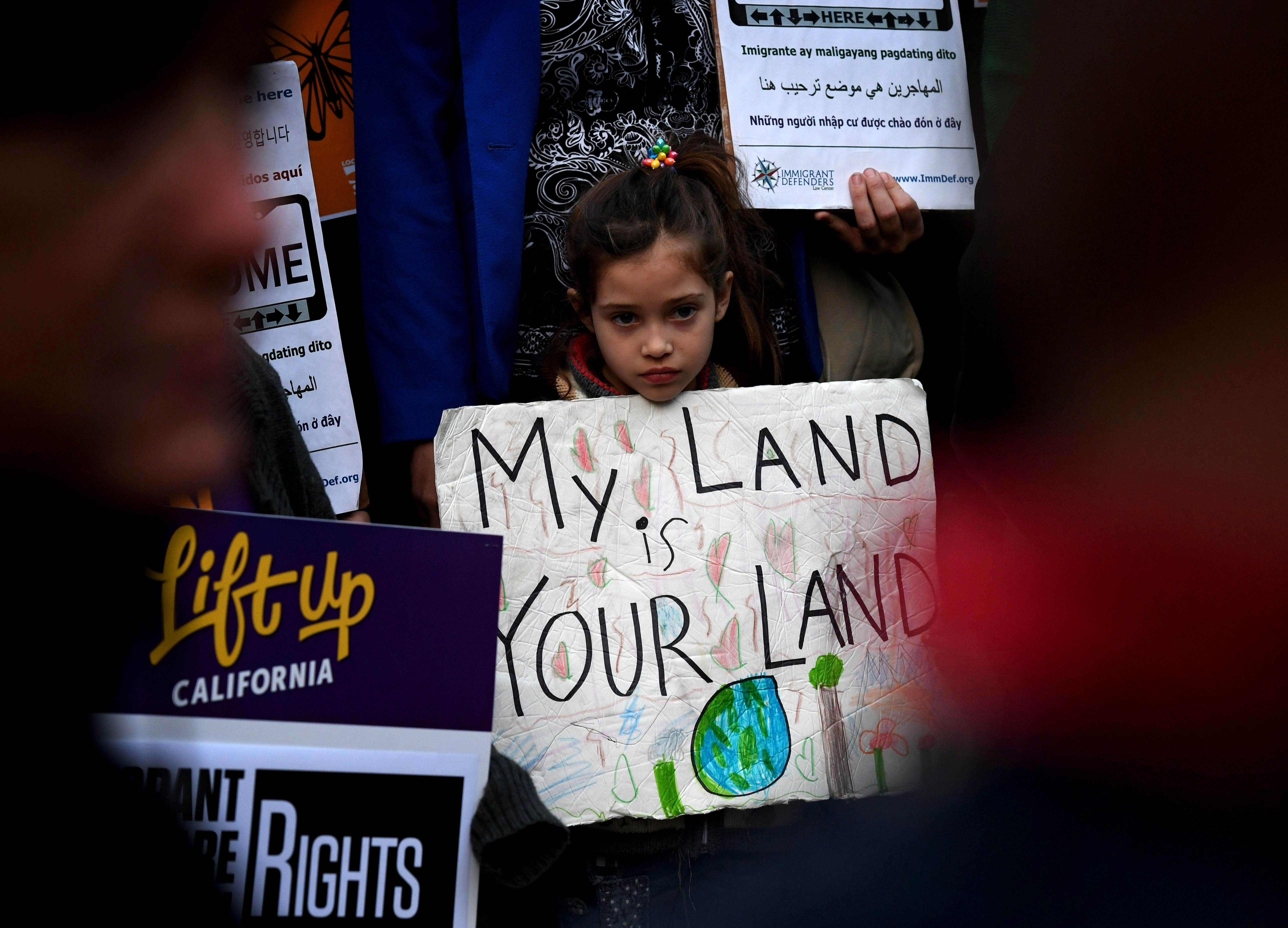 "Maya Casillas, 7, joins migrant rights group during a vigil to protest against US President Donald Trump's new crackdown on ""sanctuary cities"", outside the City Hall in Los Angeles on January 25, 2017.Some 300 such cities, counties or states -- from New York to Los Angeles -- exist throughout the United States, and many of them have vowed since Trump's election to protect the estimated 11 million undocumented migrants living in the country. / AFP / Mark RALSTON (Photo credit should read MARK RALSTON/AFP/Getty Images)"