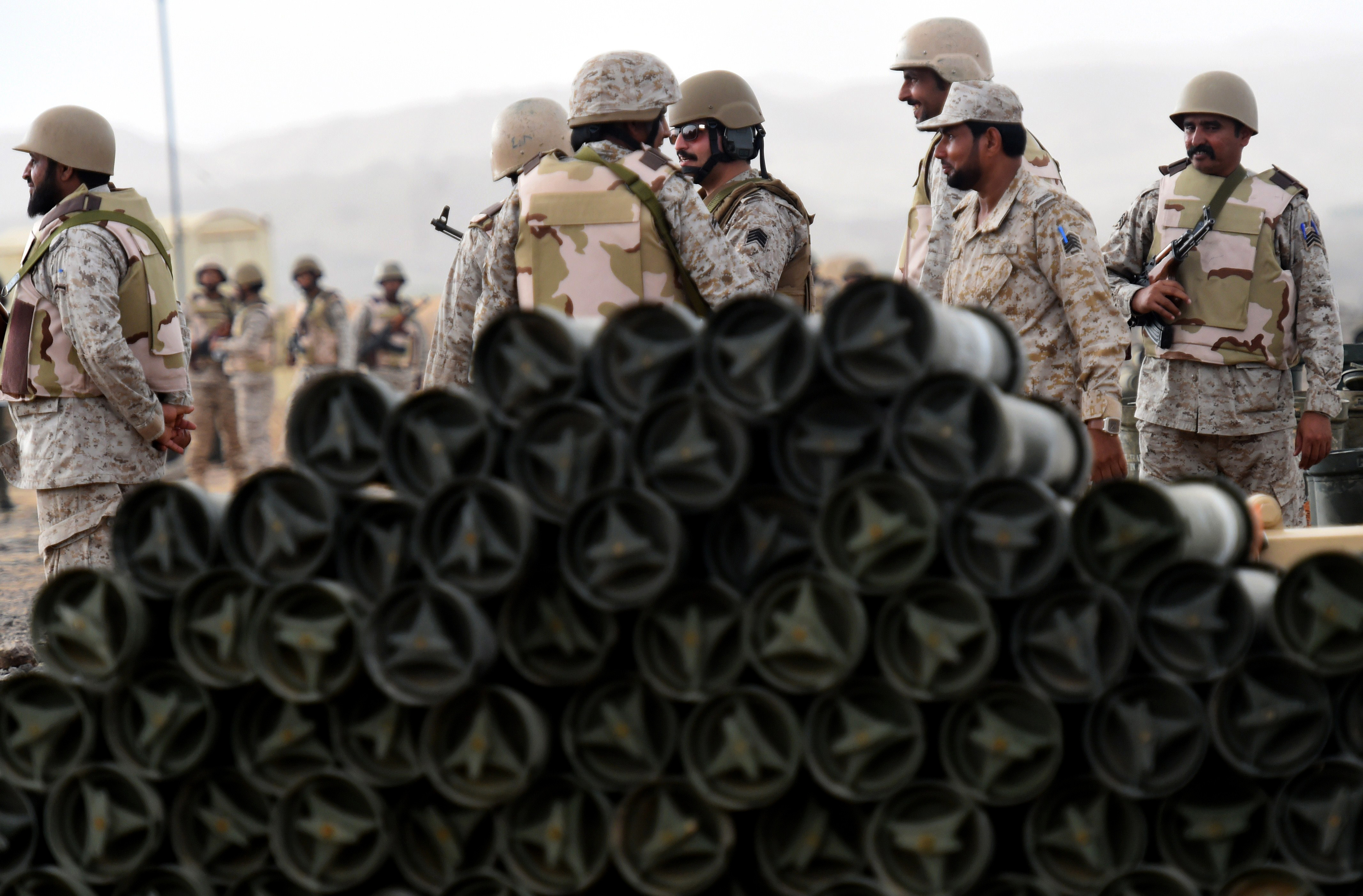 Saudi soldiers from an artillery unit stand behind a pile of ammunition at a position close to the Saudi-Yemeni border, in southwestern Saudi Arabia, on April 13, 2015. Saudi Arabia is leading a coalition of several Arab countries which since March 26 has carried out air strikes against the Shiite Huthis rebels, who overran the capital Sanaa in September and have expanded to other parts of Yemen. AFP PHOTO / FAYEZ NURELDINE        (Photo credit should read FAYEZ NURELDINE/AFP/Getty Images)