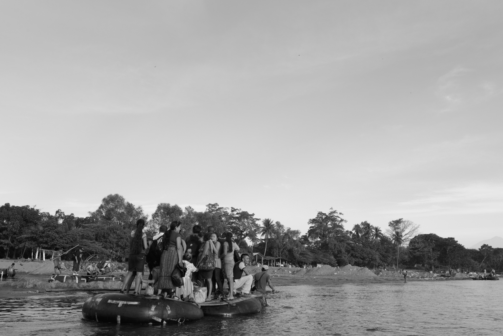 People illegally cross the Suchiate River that marks the Mexico/Guatemala border wishing sight of a bridge that holds an official crossing. There is little immigration enforcement and people cross openly to migrate and buy and sell goods. Factory-made goods like toothpaste, toilet paper, soft drinks leave Mexico here and vegetables, workers and migrants arrive.