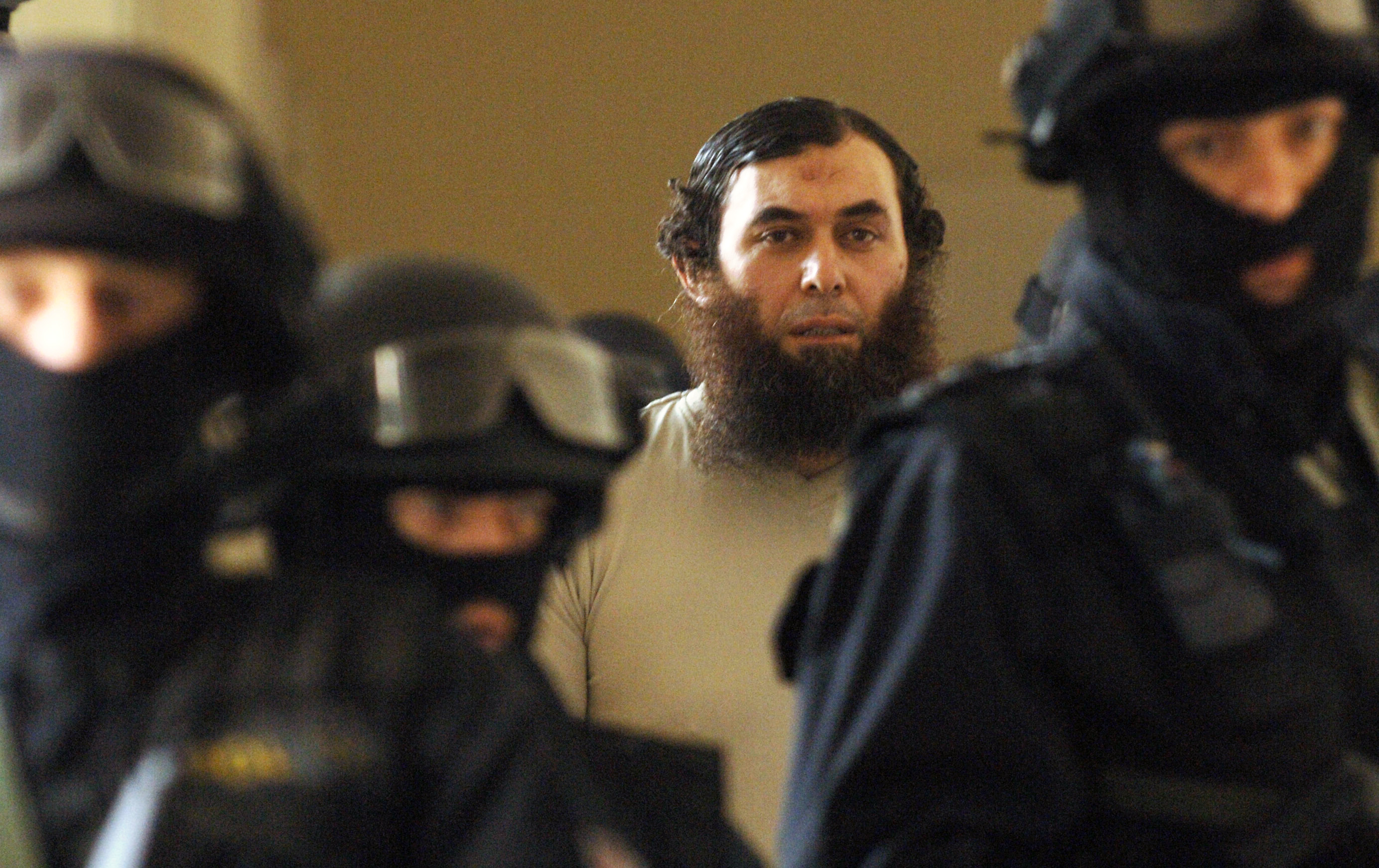 Oussama Kassir, center, Lebanese-born Swedish citizen wanted in the United States on suspicion of plotting to set up a terrorist camp there, is escorted by heavily armed policemen to the courtroom in Prague on Wednesday, April 25, 2007. The Czech court ruled today that Oussama Kassir can be extradited to the USA however he immediately appealed the decision of the Municipal Court in Prague. Kassir is charged in the USA with conspiracy aimed at providing material support to terrorists for which he faces up to a life sentence if found guilty. Kassir was arrested by the Czech police upon an international arrest warrant at Prague's Ruzyne airport during a stop-over of his plane flying from Stockholm to Beirut in December 2005. (AP Photo/CTK) ** SLOVAKIA OUT **